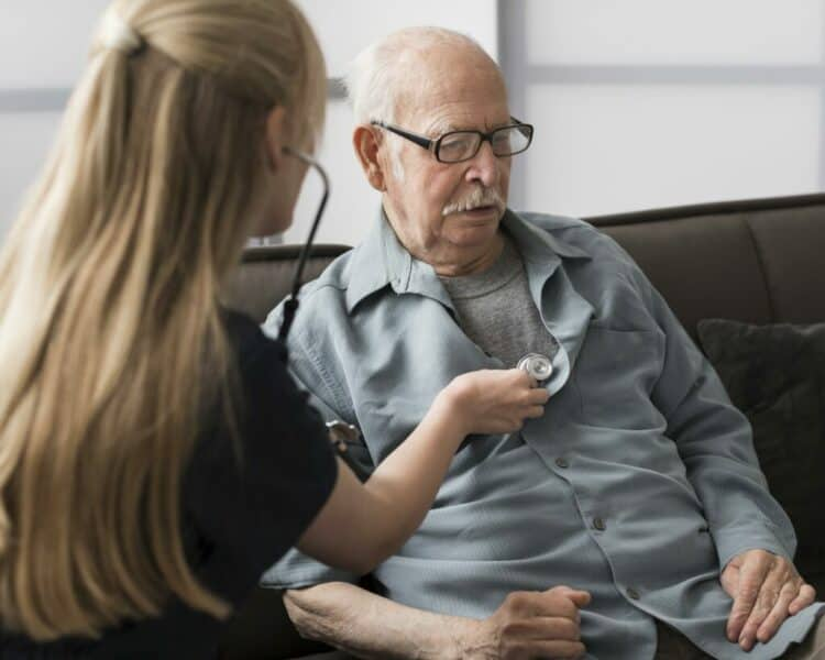 old-man-cared-for-by-nurse