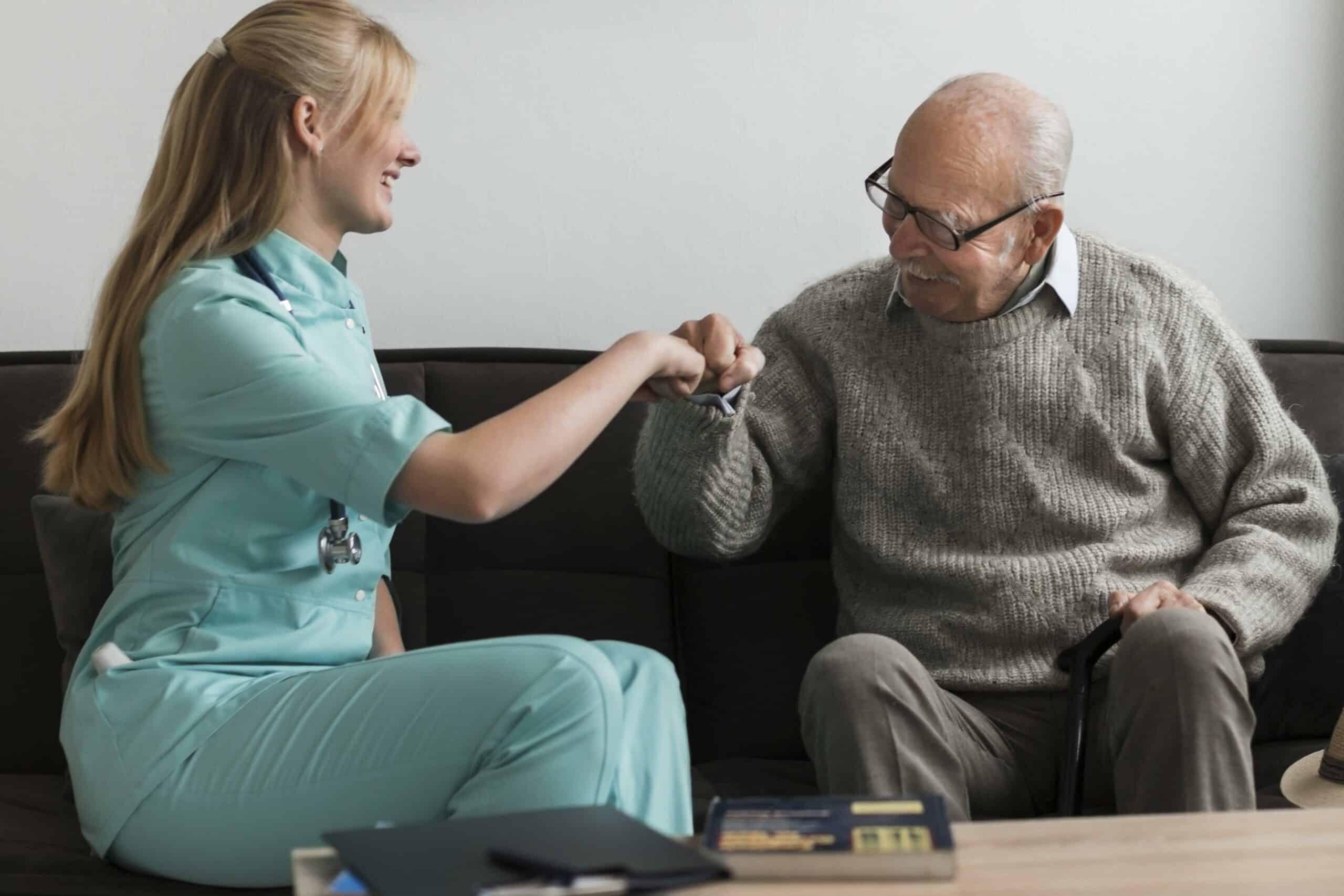 old-man-nursing-home-fist-bumping-nurse